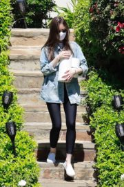 Lily Collins carry some toilet paper rolls visiting a family member in Los Angeles 2020/04/15 9