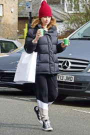 Lily James seen in Red Head Cap with Puppy Jacket Out in North London 2020/04/10 2