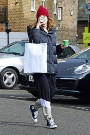 Lily James seen in Red Head Cap with Puppy Jacket Out in North London 2020/04/10 3