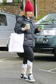 Lily James seen in Red Head Cap with Puppy Jacket Out in North London 2020/04/10 7