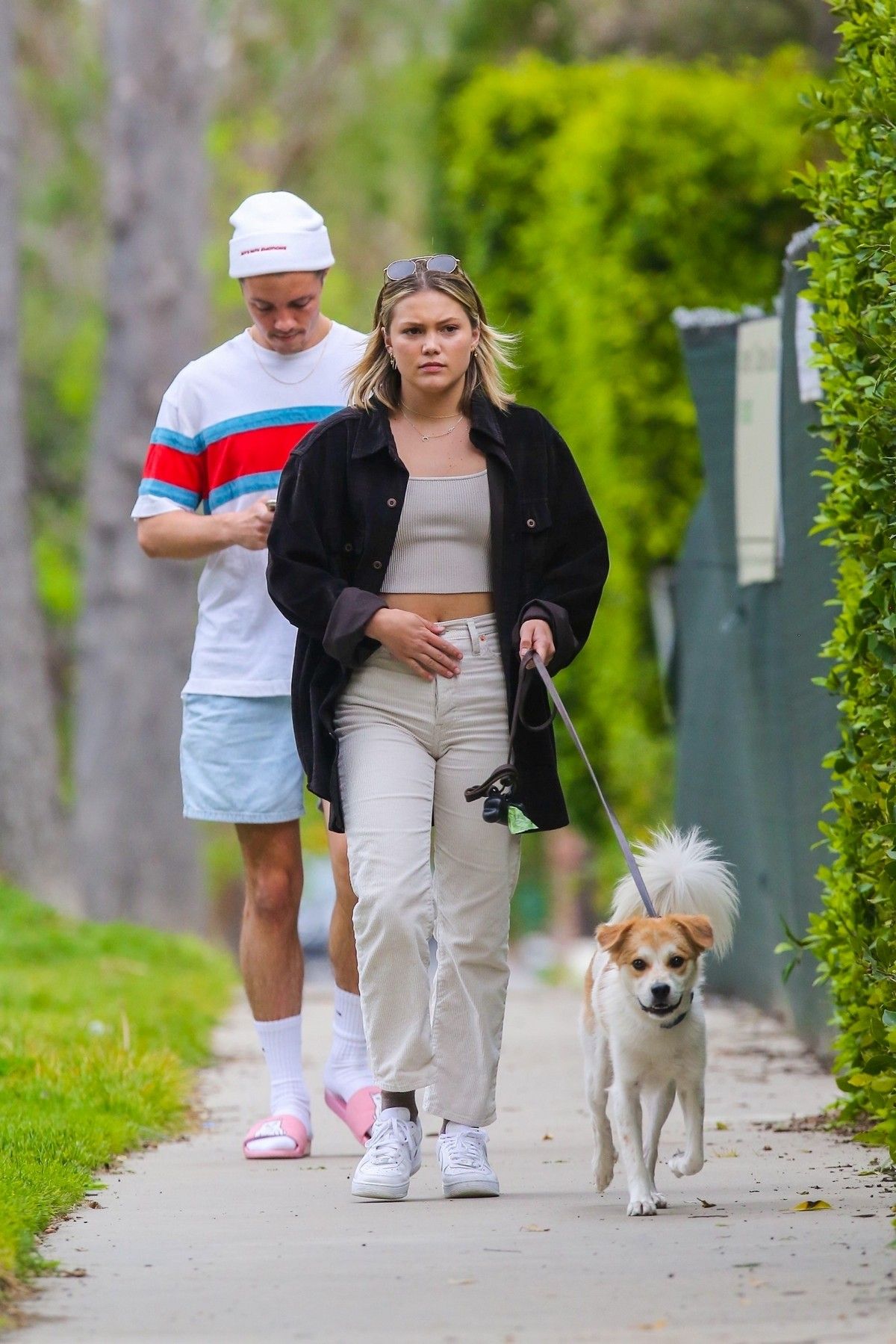 Olivia Holt walks her dog with a friend in Los Angeles 2020/03/31 6
