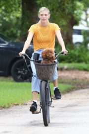 Devon Windsor Out Riding a Bike with Her Dog in Miami 2020/06/06 9