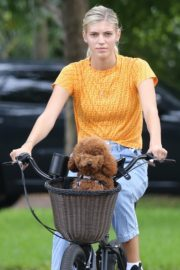 Devon Windsor Out Riding a Bike with Her Dog in Miami 2020/06/06 10