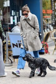 Emma Corrin in Long Coat Out with Her Dog in London 2020/10/18 2
