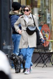 Emma Corrin in Long Coat Out with Her Dog in London 2020/10/18 3