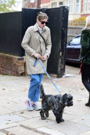 Emma Corrin in Long Coat Out with Her Dog in London 2020/10/18 10