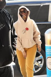 Cardi B seen in Full Face Mask at LAX Airport in Los Angeles 11/24/2020 9