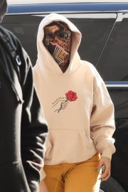 Cardi B seen in Full Face Mask at LAX Airport in Los Angeles 11/24/2020 10