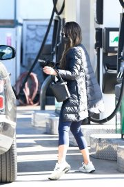 Jordana Brewster seen in Long Puffer Jacket at a Gas Station in Brentwood 12/05/2020 2