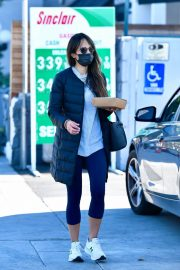 Jordana Brewster seen in Long Puffer Jacket at a Gas Station in Brentwood 12/05/2020 11