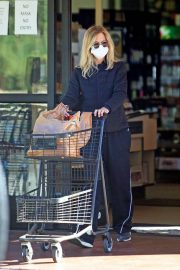Meg Ryan in Puffer Jacket and Track Paints Out Shopping in Santa Monica 11/24/2020 2