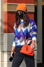 Bella Hadid Leaves Her Apartment in Orange Cap with Check Sweater 02/11/2021 12