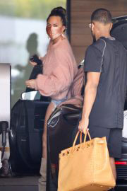 Chrissy Teigen in a Pink Top and Denim Shorts Out in Los Angeles 02/11//2021 3