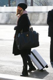 Kristin Cavallari in a Leopard Print Face Mask at LAX Airport in Los Angeles 02/11/2021 1