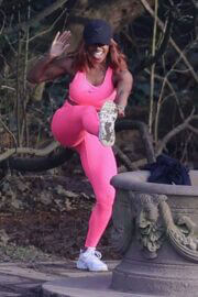 Alexandra Burke Complete Her Sports Look in Bold Pink Sportswear as She Workout at a Park in London 03/10/2021 1