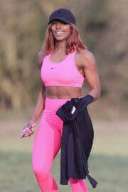 Alexandra Burke Complete Her Sports Look in Bold Pink Sportswear as She Workout at a Park in London 03/10/2021 2