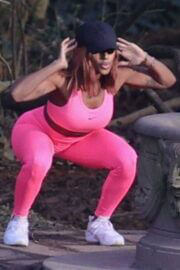 Alexandra Burke Complete Her Sports Look in Bold Pink Sportswear as She Workout at a Park in London 03/10/2021 3