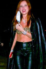 Bella Thorne Flashes Her Abs in a Crop Top and Leather Bottom as She Arrives at Her Manager's Birthday Bash in Hollywood 03/14/2021 6
