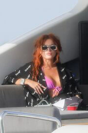 Bella Thorne Flashes Her Cleavage in Violet Bikini as She Enjoys at a Boat in Miami Beach 03/11/2021 1