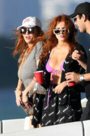 Bella Thorne Flashes Her Cleavage in Violet Bikini as She Enjoys at a Boat in Miami Beach 03/11/2021 4