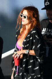 Bella Thorne Flashes Her Cleavage in Violet Bikini as She Enjoys at a Boat in Miami Beach 03/11/2021 6