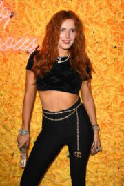Bella Thorne Flashes Her Toned Arm in Crop Top as She Hosts DJ Set and Listening Party at Sugar Factory in Miami 03/11/2021 1