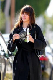 Camila Morrone in Black Coat and Matching Boots Out in Los Angeles 03/11/2021 1