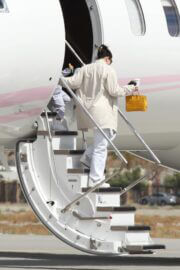 Kylie Jenner Seen on Her Private Jet in Palm Springs 03/12/2021 1