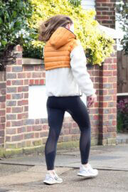 Olivia Wilde in Hoodie Jacket Out for Jogging in London 03/12/2021 1