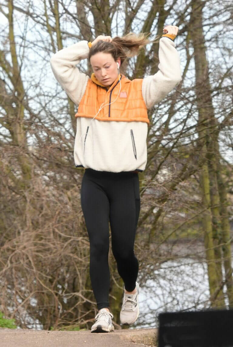 Olivia Wilde in Hoodie Jacket Out for Jogging in London 03/12/2021 3