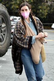 Scout Willis sweetly covers her pet from the rain at Brentwood Country Mart 03/10/2021 3