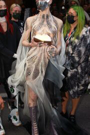 Grimes with Sword and Metal Mask to 2021 Met Gala in New York 09/13/2021 5